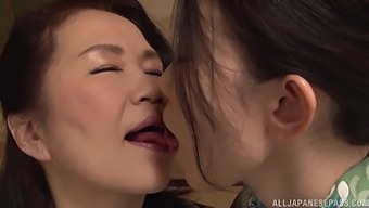 Lesbo Babes From Japan Enjoy Kissing And Scissoring On The Bed