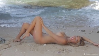 Beautiful Needled On Blond Stripping And Requesting At The Seashore