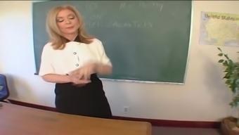 Mature Instructor Nina Hartley Bends Over The Desk To Produce A Fuck