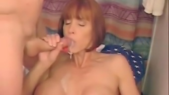 Red-Haired Milf With The Use Of Big Silicone Titties Sucks And Impact A Huge Dong