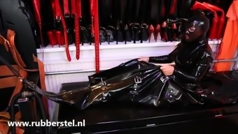 Rubbergirl In Large Plastic Servitude