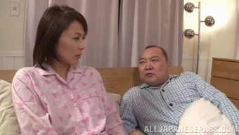 Short Haired Asian Companion Hands Wrists And Fingers Herself While Her Hubby Slumbers