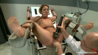 Locked Down Black Gets Bound And Fucked Using A Health Professional