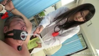 Sizzling Japanese Health Professional By Using Glasses Delivering A Handjob To Really Her Affected Person