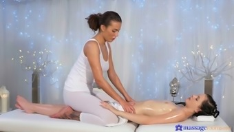 Slippery Lesbian Divas Lick One Another On The Massage Tables