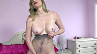 Lady By Using Pantyhose Acts With The Use Of Herself