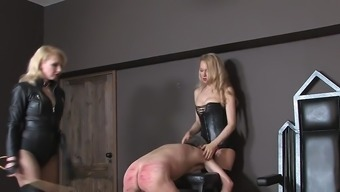 Two Different Blonde Mistresses Whipping Male Person Who Serves 01