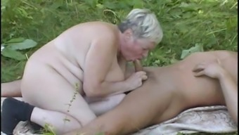 Hot Granny Offers A Bad Blowjob After That Gets Nailed Open Air