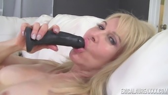 Erica Lauren Has Experience With Using A Dark Colored Dildo With Her Warm Pussy