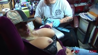 Shyla Stylez Gets Tattooed While Topless